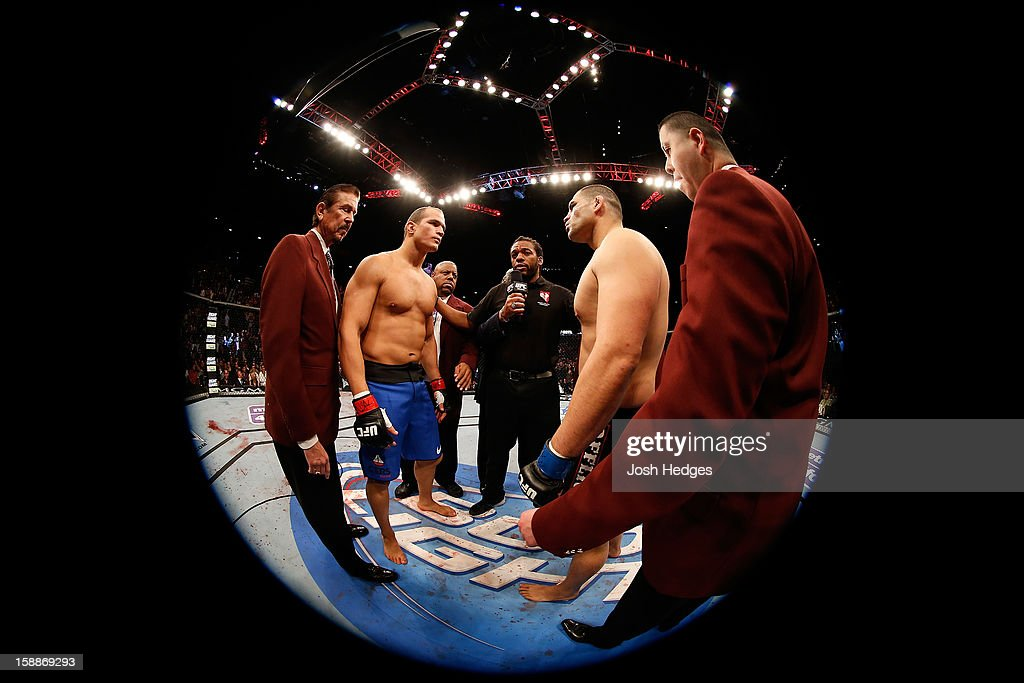 Opponents Junior dos Santos (L) and Cain Velasquez (R) face off before their heavyweight championship fight at UFC 155 on December 29, 2012 at MGM Grand Garden Arena in Las Vegas, Nevada.