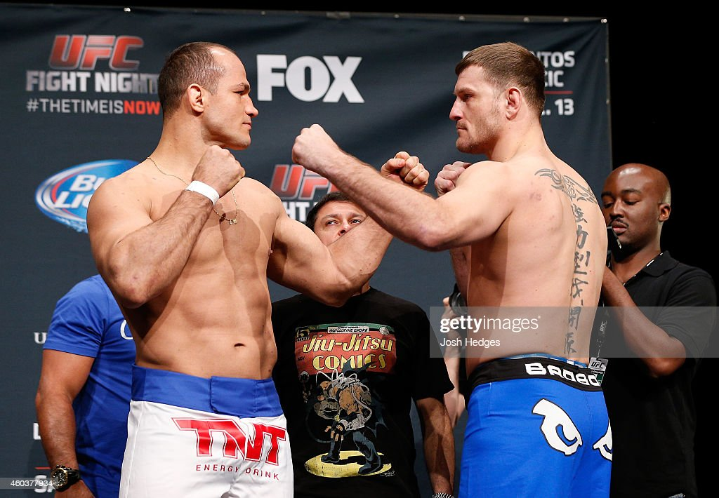 Opponents Junior Dos Santos of Brazil and Stipe Miocic face off during the UFC Fight Night weigh-in event at the Phoenix Convention Center on December 12, 2014 in Phoenix, Arizona.
