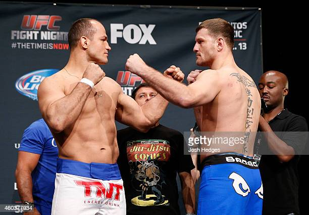Opponents Junior Dos Santos of Brazil and Stipe Miocic face off during the UFC Fight Night weighin event at the Phoenix Convention Center on December...