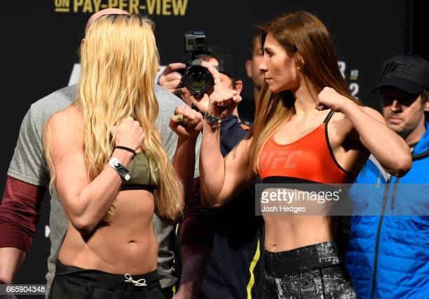 Opponents Katlyn Chookagian and Irene Aldana of Mexico face off during the UFC 210 weighin at the KeyBank Center on April 7 2017 in Buffalo New York