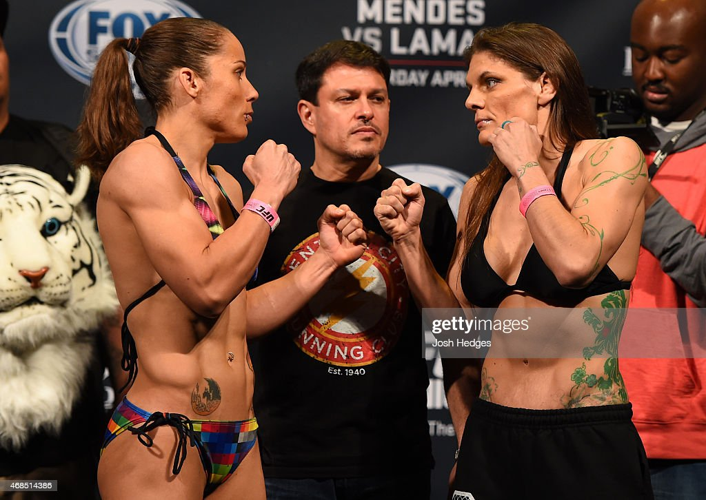 Opponents <a gi-track='captionPersonalityLinkClicked' href=/galleries/search?phrase=Liz+Carmouche&family=editorial&specificpeople=7139916 ng-click='$event.stopPropagation()'>Liz Carmouche</a> and Lauren Murphy face off during the UFC weigh-in at the Patriot Center on April 3, 2015 in Fairfax, Virginia.
