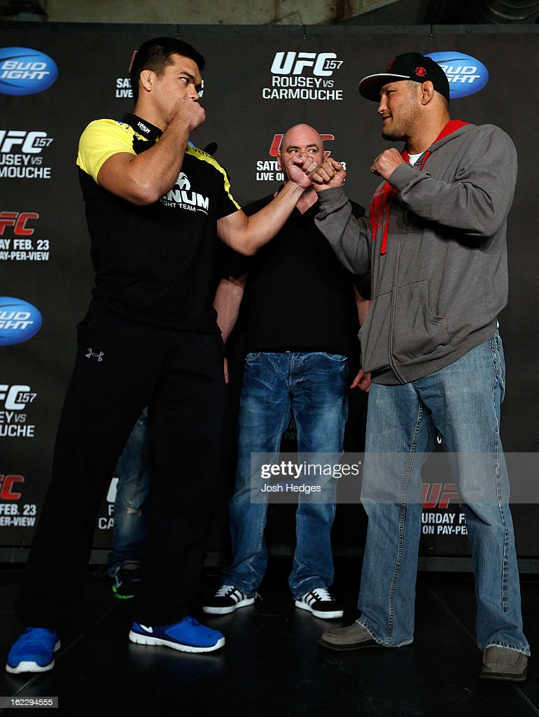 Opponents <a gi-track='captionPersonalityLinkClicked' href=/galleries/search?phrase=Lyoto+Machida&family=editorial&specificpeople=4137146 ng-click='$event.stopPropagation()'>Lyoto Machida</a> and Dan Henderson face off during a UFC pre-fight press conference at Honda Center on February 21, 2013 in Anaheim, California.