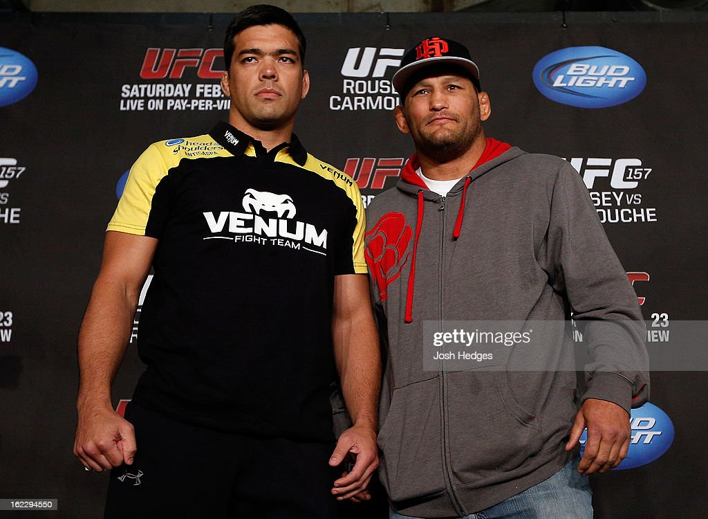 Opponents <a gi-track='captionPersonalityLinkClicked' href=/galleries/search?phrase=Lyoto+Machida&family=editorial&specificpeople=4137146 ng-click='$event.stopPropagation()'>Lyoto Machida</a> and Dan Henderson pose for photos during a UFC pre-fight press conference at Honda Center on February 21, 2013 in Anaheim, California.