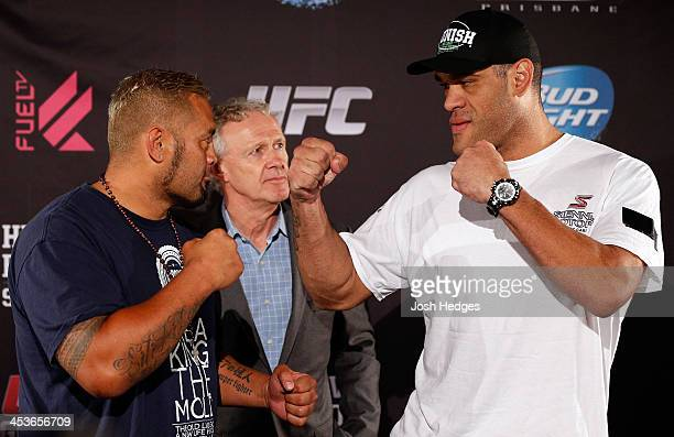 Opponents Mark Hunt and Antonio 'Bigfoot' Silva face off during the UFC Ultimate Media Day at the Brisbane Marriott Hotel on December 5 2013 in...