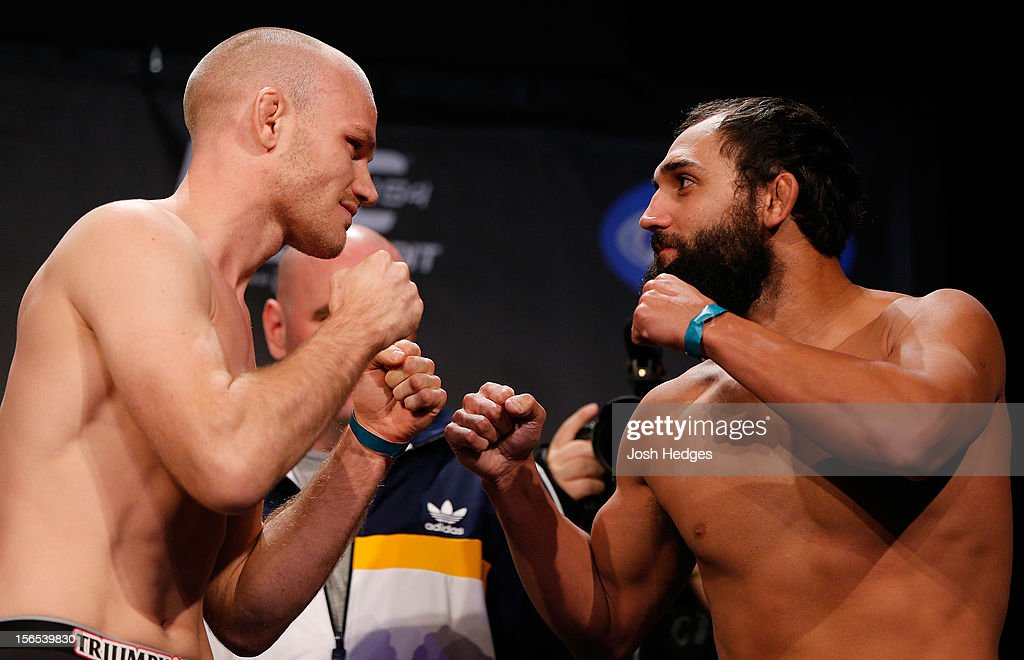 Opponents <a gi-track='captionPersonalityLinkClicked' href=/galleries/search?phrase=Martin+Kampmann&family=editorial&specificpeople=5525013 ng-click='$event.stopPropagation()'>Martin Kampmann</a> and Johny Hendricks face off during the official UFC 154 weigh in at New City Gas on November 16, 2012 in Montreal, Quebec, Canada.