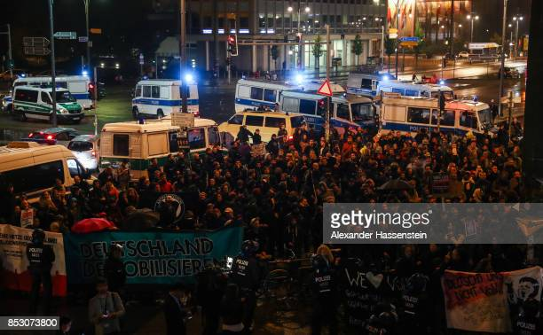 Opponents of the Alternative for Germany protest against the result of the the AfD after reaching a third place finish in German federal elections on...