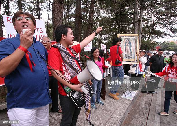 Opponents of the controversial birth control or Reproductive Health law react in front of the supreme court's summer residence in Baguio City...