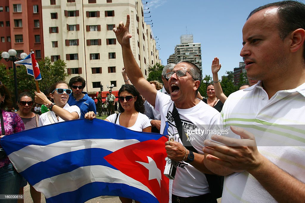 Opponents of the Cuban government demonstrate near the monument of Cuban national hero Jose Marti at a square in Santiago, in the framework of the Latin American and Caribbean States (CELAC)-European Union (EU) Summit, on January 27, 2013. European and Latin American leaders have pledged to shun protectionism and boost their strategic partnership to foster free trade and sustainable development based on close international cooperation. Some 60 countries are represented at the summit between the 27-member European Union and the Community of Latin American and Caribbean States, or CELAC. AFP PHOTO / GERALDO CASO