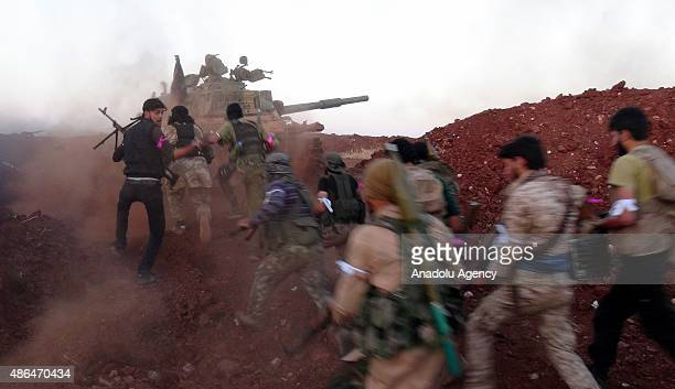 Opponents of the Syrian regime run as they carry out an operation on the Hezbollah controlled Fua village in the northeast Idlib Syria on September 3...