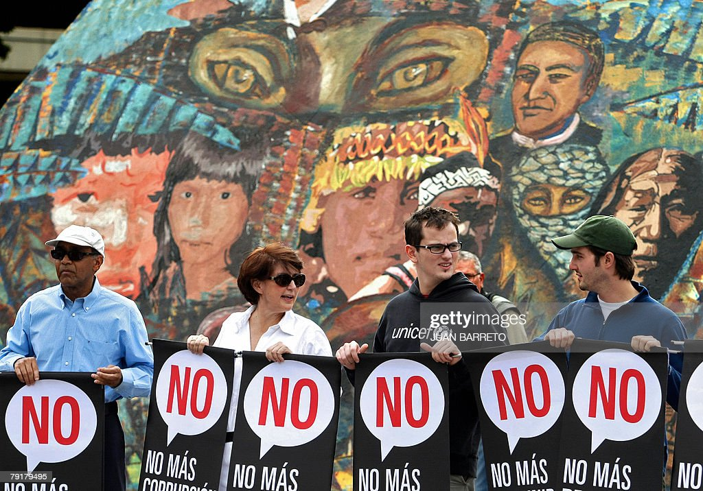 Opponents of Venezuelan president Hugo Chavez hold signs reading 'No' during a demonstration 23 January, 2008 in Caracas. The Venezuelan government commemorated today the 50th anniversary of the fall of the last dictatorship -gen. Marcos Perez Jimenez (1948-58). AFP PHOTO/Juan BARRETO