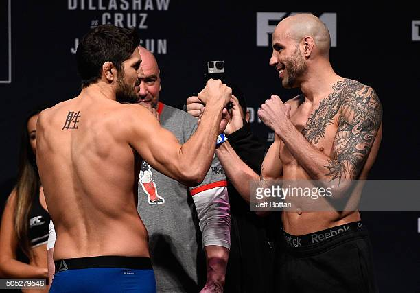 Opponents Patrick Cote of Canada and Ben Saunders face off during the UFC weighin at the Wang Theatre on January 16 2016 in Boston Massachusetts