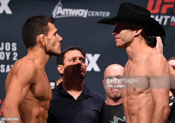 Opponents Rafael dos Anjos of Brazil and Donald 'Cowboy' Cerrone face off during the UFC weighin at the Orange County Convention Center on December...