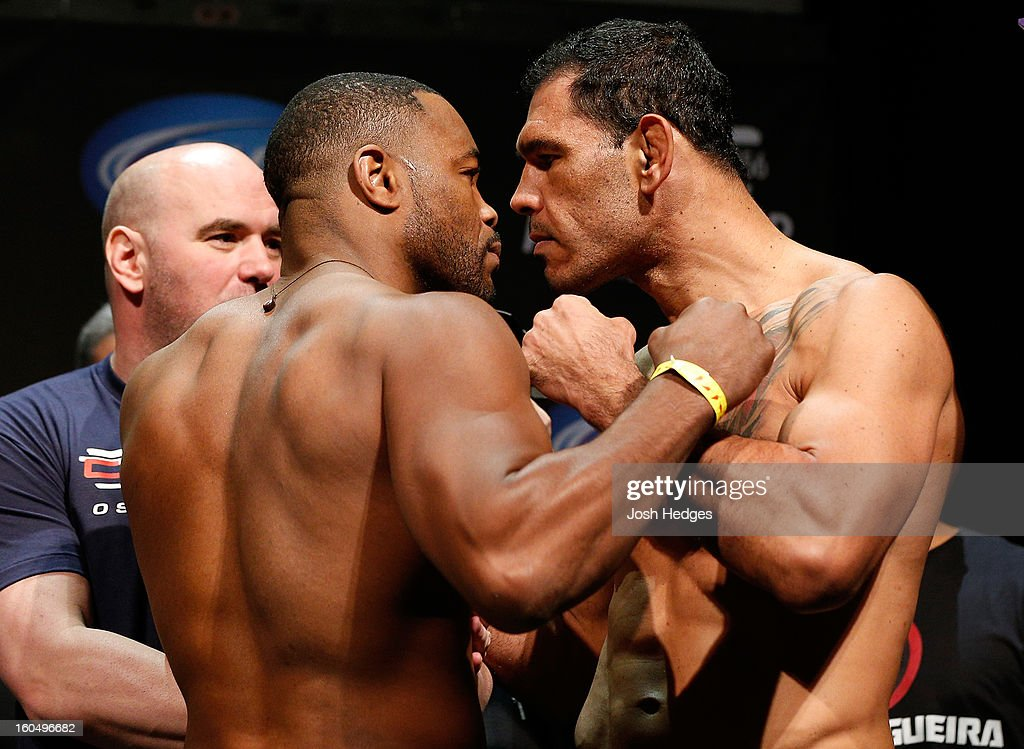 Opponents <a gi-track='captionPersonalityLinkClicked' href=/galleries/search?phrase=Rashad+Evans&family=editorial&specificpeople=2312276 ng-click='$event.stopPropagation()'>Rashad Evans</a> and Antonio Rogerio Nogueira face off during the UFC 156 weigh-in on February 1, 2013 at Mandalay Bay Events Center in Las Vegas, Nevada.