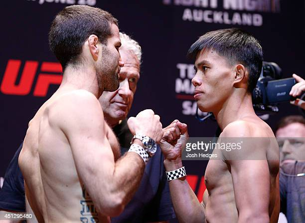 Opponents Richie Vaculik and Roldan Sangchaan face off during the UFC weighin at Vector Arena on June 27 2014 in Auckland New Zealand