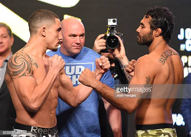 Opponents Robert Whittaker of New Zealand and Rafael Natal of Brazil face off during the UFC 197 weighin at the MGM Grand Garden Arena on April 20...