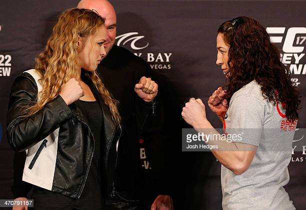 Opponents Ronda Rousey and Sara McMann face off during the final UFC 170 prefight press conference at the Mandalay Bay Resort and Casino on February...