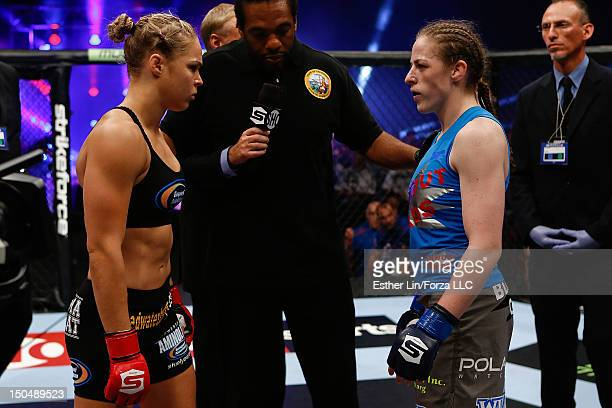 Opponents Ronda Rousey and Sarah Kaufman receive final instructions from referee Herb Dean before their bout during the Strikeforce event at Valley...