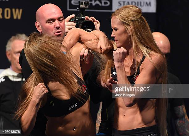 Opponents Ronda Rousey of the United States and Holly Holm of the United States face off during the UFC 193 weighin at Etihad Stadium on November 14...