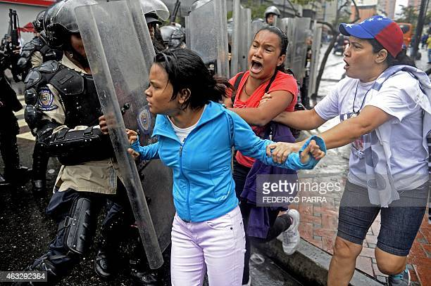 Opponents to Venezuelan President Nicolas Maduro confront members of the national police during a protest in Caracas Venezuela on February 12 2015...