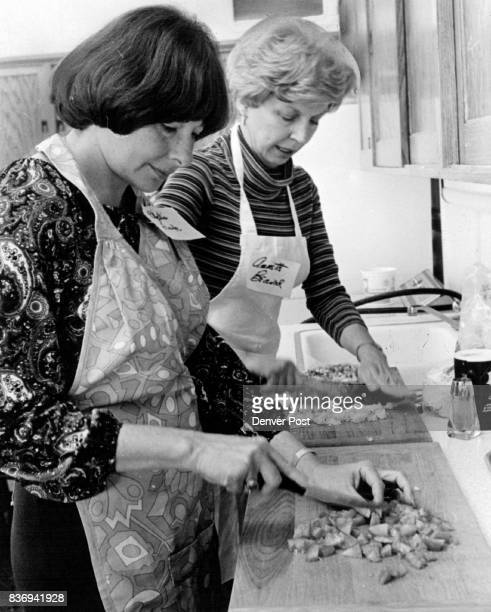 Opportunity School Phyllis Frank left and Annette Beaird are chopping vegetables for an eggplant casserole which takes only a few minutes to bake in...