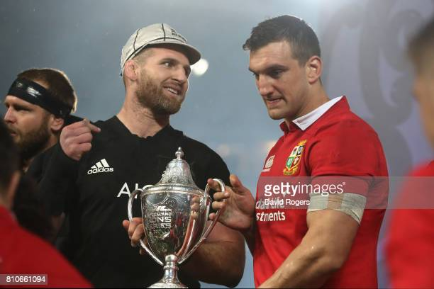 Opposing captains Kieran Read of the All Blacks and Sam Warburton of the Lions lift the trophy following a drawn series during the third test match...