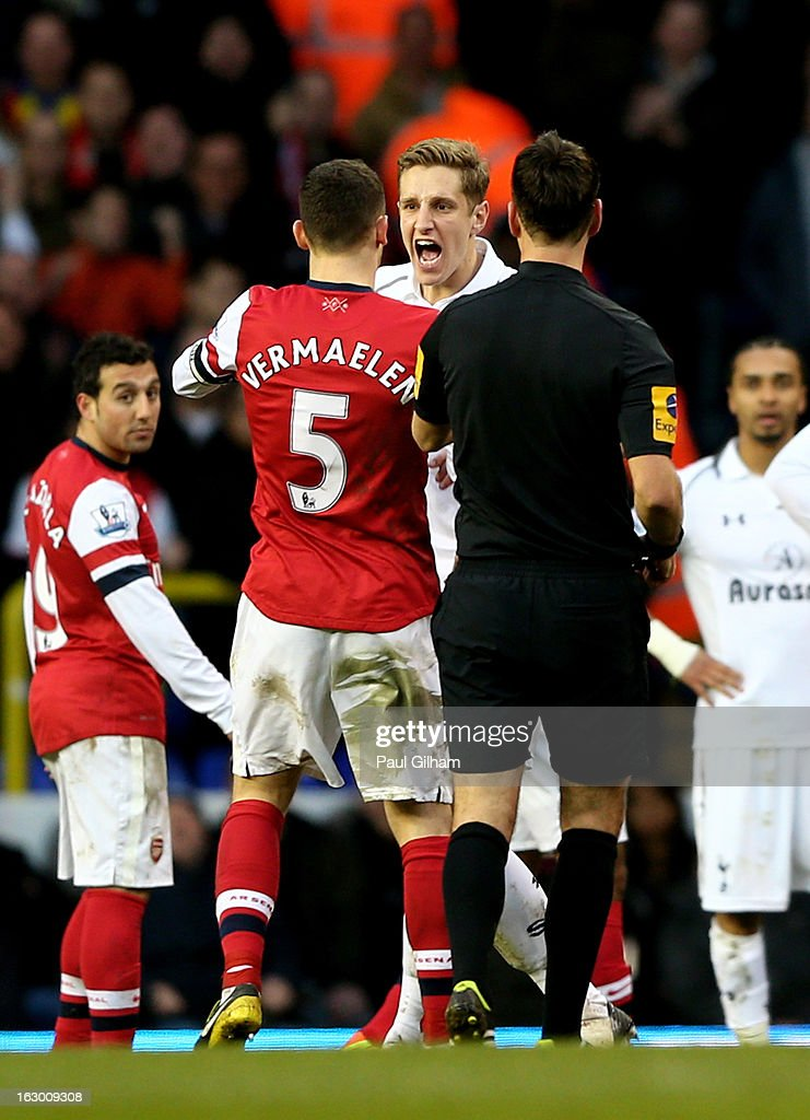 Opposing captains Thomas Vermaelen of Arsenal and Michael Dawson of Spurs clash during the Barclays Premier League match between Tottenham Hotspur and Arsenal FC at White Hart Lane on March 3, 2013 in London, England.