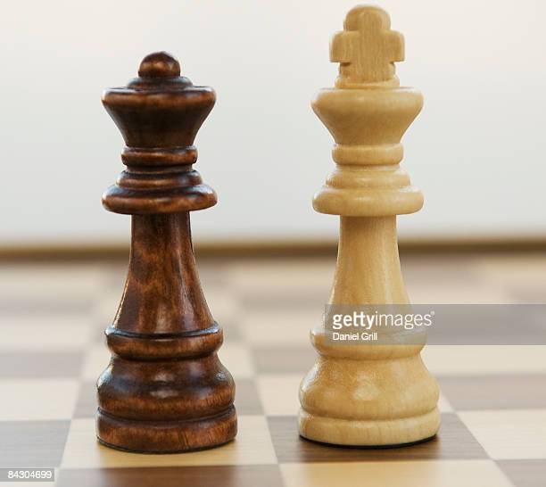 Opposing king and queen chess pieces