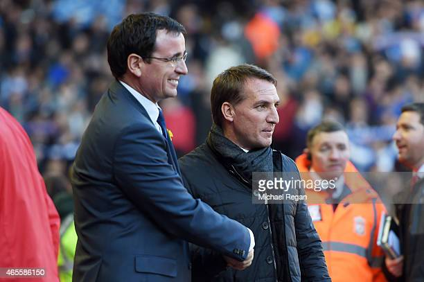 Opposing managers Gary Bowyer the manager of Blackburn and Brendan Rodgers the manager of Liverpool pose for a photo prior to kickoff during the FA...