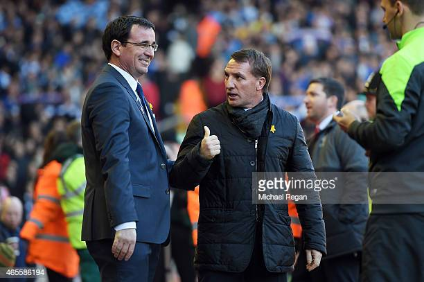 Opposing managers Gary Bowyer the manager of Blackburn and Brendan Rodgers the manager of Liverpool chat prior to kickoff during the FA Cup Quarter...
