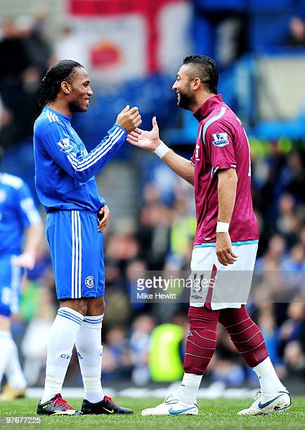 Opposing strikers Didier Drogba of Chelsea and Mido of West Ham greet each other prior to kickoff during the Barclays Premier League match between...
