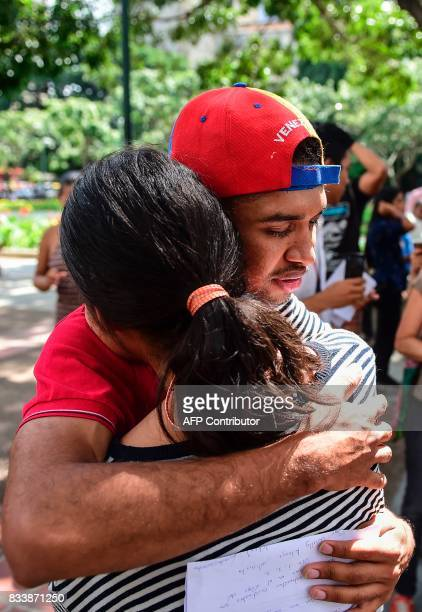 Opposition activist and violinist Wuilly Arteaga embraces a woman at Altamira square in Caracas on August 17 2017 The young violinist who became a...