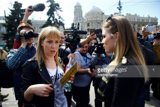 Opposition activist Maria Baronova and proKremlin political activist Maria Katasonova meet before an unsanctioned protest in downtown in Moscow...