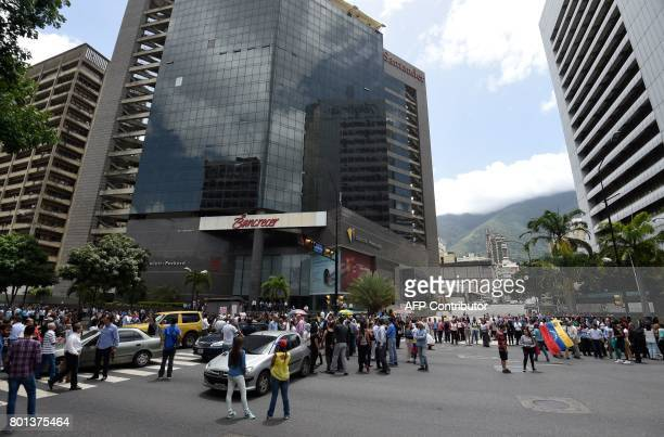 Opposition activists block avenues in Caracas as they demonstrate against the government of President Nicolas Maduro on June 26 2017 A political and...