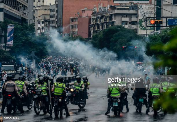 TOPSHOT Opposition activists clash with riot police during a demo in Caracas on June 7 2017 The head of the Venezuelan military General Vladimir...