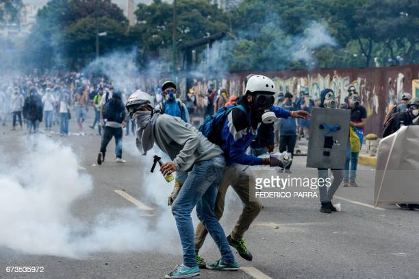 TOPSHOT Opposition activists clash with riot police during a protest against President Nicolas Maduro in Caracas on April 26 2017 Venezuelan riot...