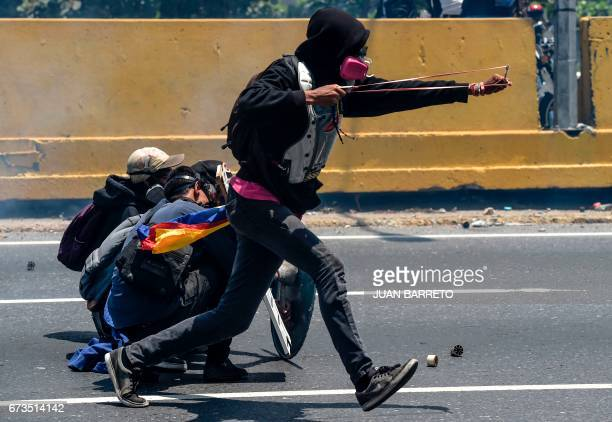 TOPSHOT Opposition activists clash with riot police during a protest in Caracas on April 26 2017 Protesters in Venezuela plan a highrisk march...