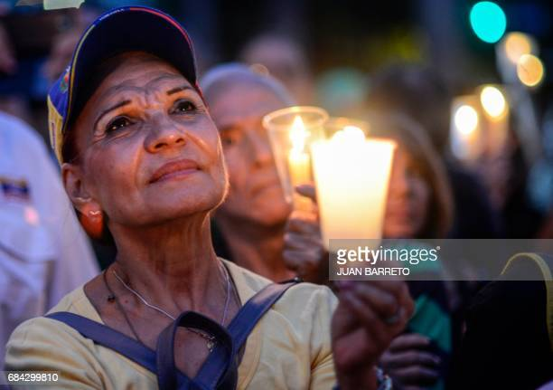 TOPSHOT Opposition activists holding candles protest against the deaths of 43 people in clashes with the police during weeks of demonstrations...
