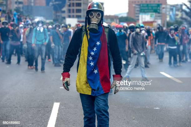 TOPSHOT Opposition activists protest against President Nicolas Maduro in Caracas on May 8 2017 Venezuela's opposition mobilized Monday in fresh...