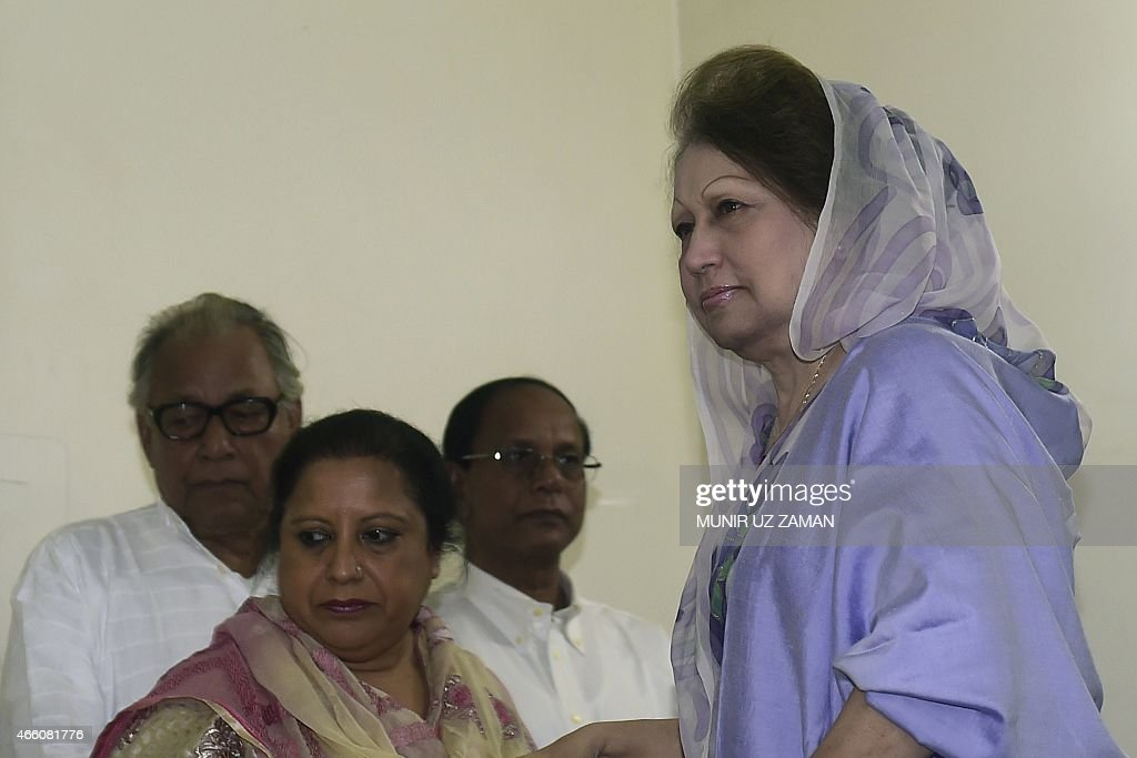 Opposition Bangladesh Nationalist Party (BNP) leader <a gi-track='captionPersonalityLinkClicked' href=/galleries/search?phrase=Khaleda+Zia&family=editorial&specificpeople=647544 ng-click='$event.stopPropagation()'>Khaleda Zia</a> (R) arrives at a press conference in Dhaka on March 13, 2015. Bangladesh's opposition leader <a gi-track='captionPersonalityLinkClicked' href=/galleries/search?phrase=Khaleda+Zia&family=editorial&specificpeople=647544 ng-click='$event.stopPropagation()'>Khaleda Zia</a> vowed March 13 to push on with her campaign to topple the government as she struck a defiant note in her first public appearance since being effectively confined to her office. AFP PHOTO / Munir uz ZAMAN