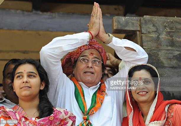 Opposition Bharatiya Janata Party candidate from Gurdaspur and Indian film actor Vinod Khanna along with his wife Kavita daughter Shraddha gestures...