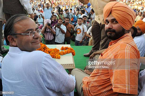Opposition Bharatiya Janata Party General Secretary Arun Jaitley and Indian cricketer turned politician sitting Member of Parliament and BJP...