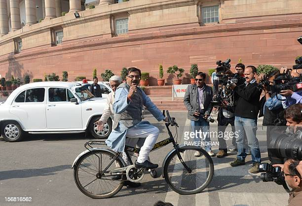 Opposition Bharatiya Janata Party Member of Parliament Tarun Vijay arrives at the Parliament House on bicycle in protest against the Congressled...