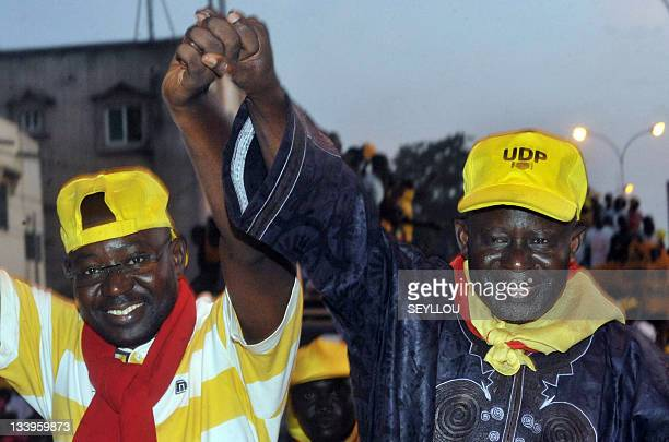 Opposition candidate Ousainou Darboe and Moral Party leader Mai Fatty salute supporters during a campaign rally on November 22 2011 in Banjul The...