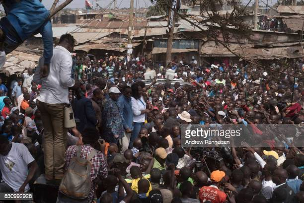 Opposition candidate Raila Odinga addresses a crowd in the Kibera slum on August 13 2017 in Nairobi Kenya A day prior demonstrations turned violent...