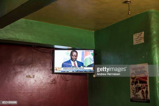 Opposition candidate Raila Odinga is seen on television in a bar in the Mathare North neighborhood on August 16 2017 in Nairobi Kenya Odinga...
