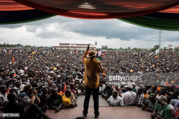 Opposition candidate Raila Odinga speaks to the crowd gathered at a rally at the Ogango Grounds on October 20 2017 in Kisumu Kenya Tensions are high...