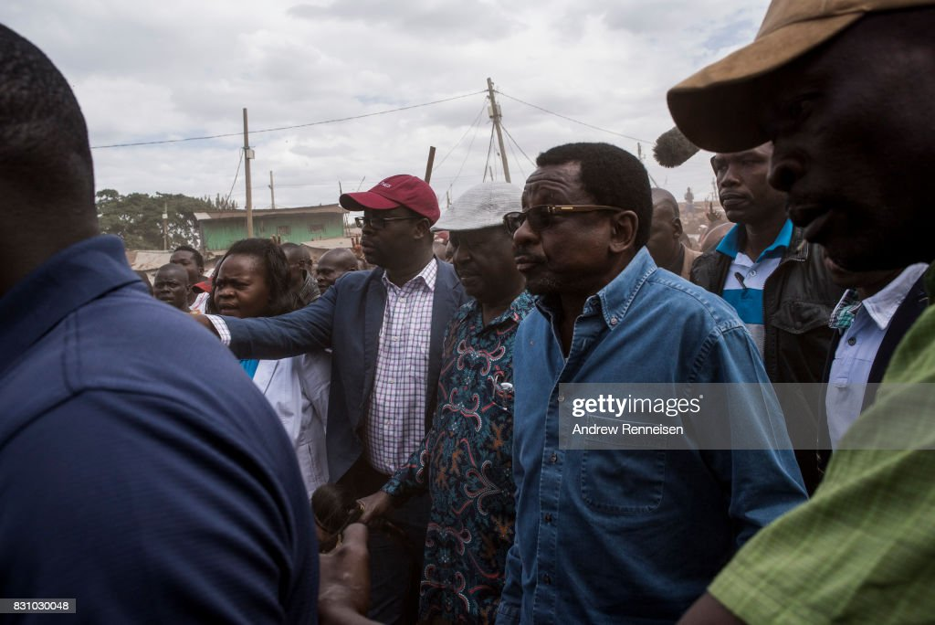 Opposition candidate Raila Odinga walks to address his supporters in the Kibera slum on August 13, 2017 in Nairobi, Kenya. A day prior, demonstrations turned violent in some areas throughout Kenya after Uhuru Kenyatta was named to his second term in Kenya's 2017 presidential election.