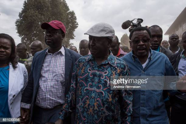 Opposition candidate Raila Odinga walks to address his supporters in the Kibera slum on August 13 2017 in Nairobi Kenya A day prior demonstrations...