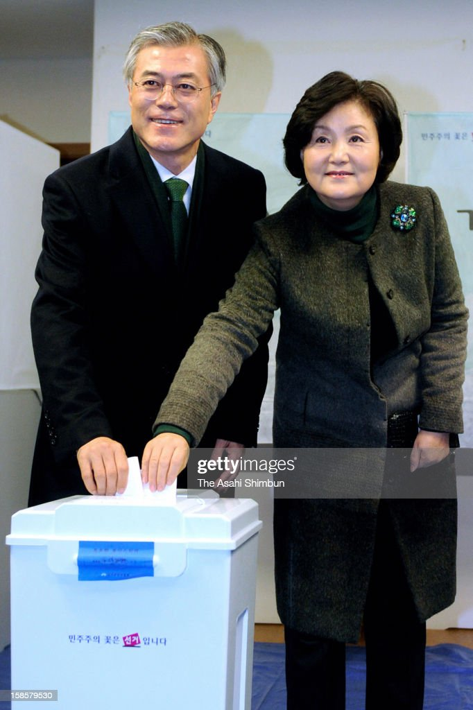 Opposition Democratci United Party presidential candidate Moon Jae-In casts a vote with his wife at a polling station on December 19, 2012 in Busan, South Korea. Park Guen-Hye, daughter of former president Park Chung-Hee, becomes the first female president of South Korea.
