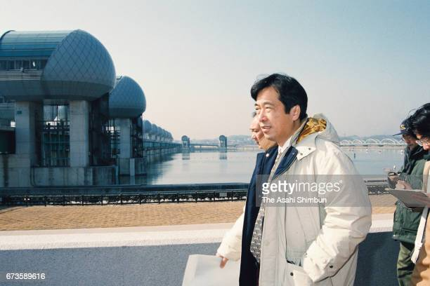 Opposition Democratic Party of Japan chief Naoto Kan inspects the Nagaragawa River Estuary Barrage on February 8 1997 in Nagasihma Mie Japan